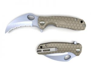Tan Honey badger claw with serrated blade.